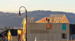 Time Lapse of Real Estate Housing Construction with Workers Framing the Roof Stock Footage