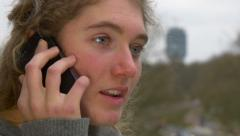beautiful mad girl talking on phone 4K Ultra HD highdef - stock footage