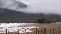 Time-lapse, abandoned barns wide shot, grey winter day Stock Footage