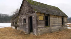 old abandoned farm home, exterior, post apocalyptic, pan - stock footage