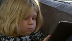 close up tierd bored child girl falling asleep playing Tablet 4K Ultra HD - stock footage