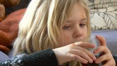 Close up gute little girl drinking and eating 4K Ultra HD Stock Footage