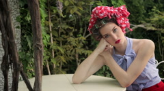 Beautiful Fashion Model Wearing Hair Curlers And Headscarf Poses In Garden - stock footage
