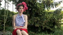 Beautiful Retro Fashion Model With Headscarf Sits On Swing In Garden - stock footage