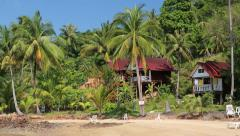 Beautiful bungalows amongst palm trees on the Koh Wai island in Thailand Stock Footage