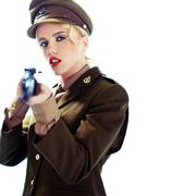 glamorous army officer aiming a rifle - stock photo