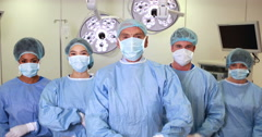 Surgical team looking at the camera in operating theater Stock Footage