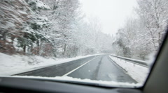 Driving on snowy road Stock Footage