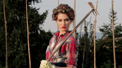Elegant Fashion Model Poses For Photo Shoot With Pickaxe In Garden Stock Footage