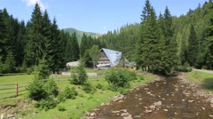 Cottage near mountain river in Carpathians, Ukraine Stock Footage