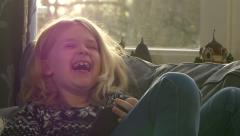 Girl laughing slow motion tablet HD Stock Footage