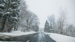 Snowy landscape seen from passenger compartment of the car Stock Footage