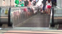 People on a moving walkway Stock Footage