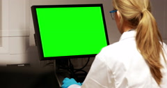 Scientist using computer with chroma key screen - stock footage