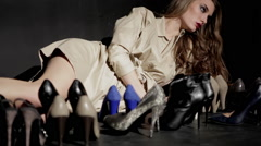 Fashion Model Poses With Multiple high heel Shoes In Foreground - stock footage