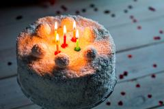 climate coconut cake for birthday with candles - stock photo