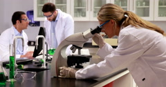 Young scientists working together in the lab Stock Footage