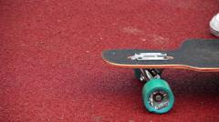 Testing balance on skate board Stock Footage