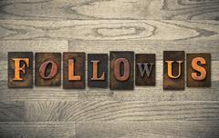 Stock Photo of follow us wooden letterpress concept
