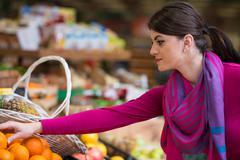 woman at groceries store - stock photo