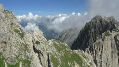 AERIAL: Over the mountain cliff towards the mountains Arkistovideo