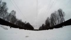 Extreme camera is mounted under the train on the rails. Suburban train passes ov Stock Footage