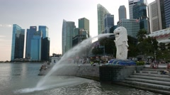 4K View of the Singapore Merlion with financial buildings Stock Footage