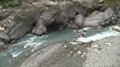 Downstream of waterfall with rocky river Stock Footage