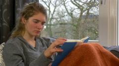Nerd girl reading book 4K Ultra HD Stock Footage