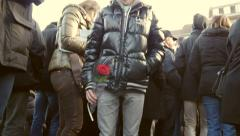 Man holding flowers at protest Stock Footage