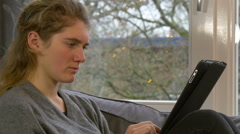 Girl on tablet playing working 4K Ultra HD - stock footage