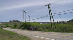 Auto accident, rolled SUV, wrecked power pole, WS Stock Footage