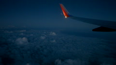 747 wing in flight at night Stock Footage
