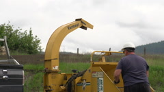 Wood chipper doing its thing, medium shot good sound Stock Footage