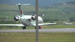 Aircraft, AC jet take off long lens, follow shot Stock Footage