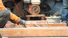 Stock Video Footage of Steel Workers welding, grinding, cutting in metal industry