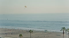 Beach in Summer with Parasailing, Palm Trees, Boat, Sand, Sunny Beautiful Ocean Stock Footage