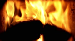 Orange fire with black wood Stock Footage