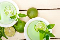 mint infusion tea tisane with lime - stock photo