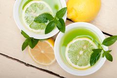 mint infusion tea tisane with lemon - stock photo