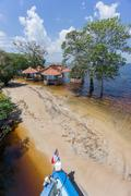 Beach with neglected cabins in the middle of Rio Negro, Brazil Stock Photos