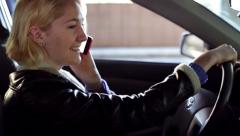 A Young Woman Talking on Phone While Driving Profile View Stock Footage