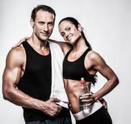 Athletic couple after fitness exercise Stock Photos