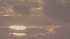 Sun rising through drifting clouds in Red Scarlet UHD Time Lapse Stock Footage