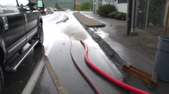 Disaster flood sump pump hose and water pan reveal Stock Footage