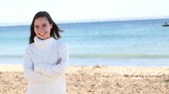 Stock Video Footage of young woman on beach with positive attitude