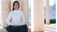 Young woman meditating outside Stock Footage
