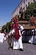 A group of bearers (called Costaleros) carrying a religous float (known as a Tro Stock Photos