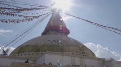 View from below of Buddhist Stupa in the sunlight, birds flying Stock Footage