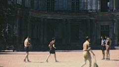 Blois 1949: boys taking pictures on the castle courtyard Stock Footage